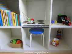 The frugal me loves this idea!!!.....IKEA Hackers: Expedit play stove - use contact paper and electrical tape to turn a bookshelf into a play stove.  Great for limited space!  IKEA also sells doors for this, so you could easily make an oven or fridge in one of the compartments too!