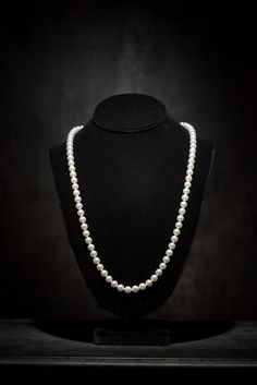 Cost: $3,250.00.   This is the Opera length strand. It is one of our most versatile necklaces. You can double loop the strand, knot it or let it hang below the bust line. It's approximately 35 inches in length and comes with our signature 18k gold clasp. http://masatopearls.com/collections/strands/products/true-white-opera-length-strand