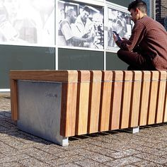 STREETLIFE Solid Skirt Bench. The FSC Hardwooden slats cover the steel base #StreetFurniture #ModernDesign #FSCHardwood