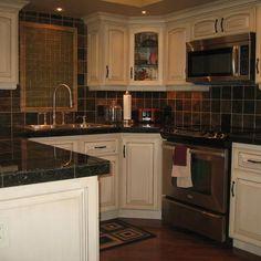 painted/glazed cabinets, granite tile countertops slate and glass backsplash...