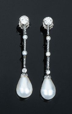 Each comprising a drop-shaped pearl measuring 8.7 and 8.9 mm diameter with a diamond-set cap and seed pearl and rose-cut diamond line all suspended from an old-cut diamond collet, circa 1900, 4.5 cm long