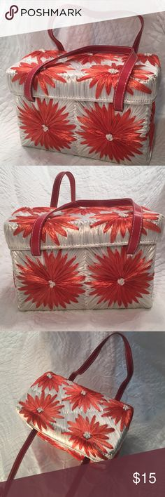 Vintage Straw Floral Handbag Beautiful vintage purse made of straw with red and white flowers.  Red leather handles. All of my listings are clean and come from a smoke-free home. Add to a bundle for an extra 25% savings! 😊 Bags