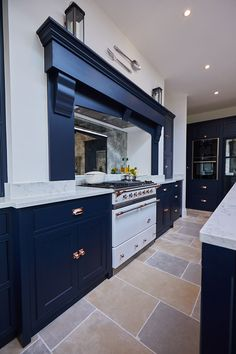 White Macon range cooker by lacanche with dark blue mantle on false chimney breast - The Main Company Rose Gold Kitchen, Navy Kitchen, Open Plan Kitchen Living Room, Home Decor Kitchen, Kitchen Interior, Kitchen Design, Kitchen Ideas, Hells Kitchen, Beautiful Kitchens