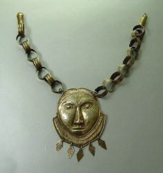 A chief's necklace, with a mase pendant mask.