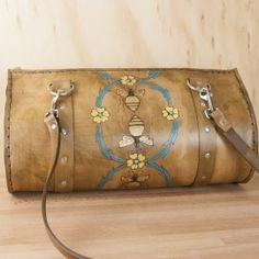 This might be my favorite purse - the Melissa Barrel Bag is a handmade leather vintage style purse by Moxie & Oliver.  The pattern is bees and flowers in a similarly vintage style.  This piece is a classic and will get better with age!
