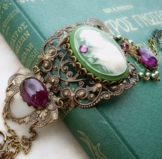 beautiful bracelet with what looks like a jade or (?) cameo and purple stones