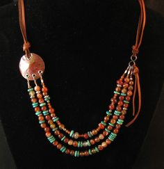 Turquoise and carnelian with multistrand connectors and leather; by dreamcatcherdesigns
