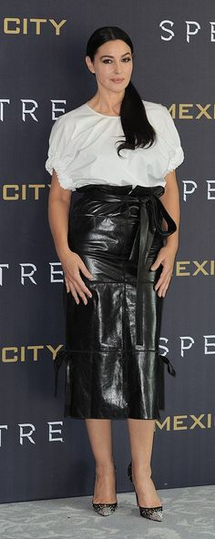 Monica Bellucci turned heads in a daring leather pencil skirt teamed with a white peasant blouse.