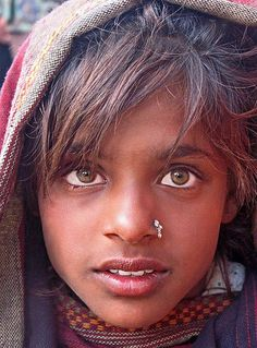 India  This girl lived in Leh. She was a street seller who had the best smile and eyes one could wish for. Three weeks after this picture was taken the town had been devastated by floods.