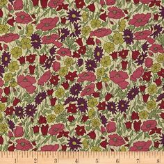 Liberty Of London Tana Lawn Poppy and Daisy Green from @fabricdotcom  From the world famous Liberty Of London, this exquisite cotton lawn fabric is finely woven, light weight and ultra soft. This gorgeous fabric is oh so perfect for flirty blouses, dresses, lingerie, tunics, tops and more. Colors include purple, medium pink, magenta and sage green.
