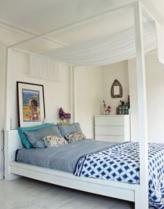 This MALM Bed Frame gets a sophisticated update with the addition of four beams and a chic piece of white cloth draped on top. Bonus: It's a fraction of the price of your average four-poster piece. Get the tutorial at Hester's Handmade Home »   - HouseBeautiful.com
