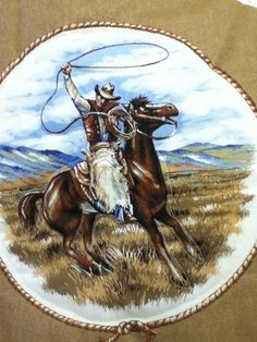 $350.00 Handmade quilt with machine quilting. Ranch cowboys in all areas of life, roping, steer wrestling, by the campfire, bronc riding and more.