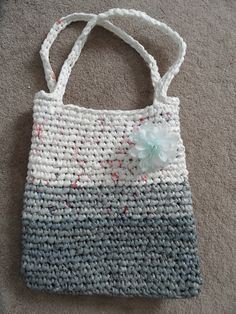 Recycled plastic shopping bags & DIY!!!    Just cannot get rid of them!   Made this bag out of plenty of plastic bags!
