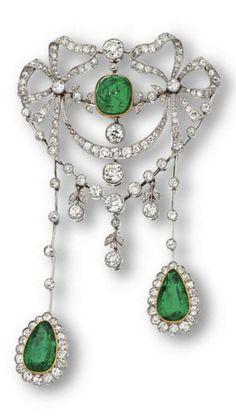 A Belle Epoque emerald and diamond pendant-brooch, circa 1910. Designed as a…