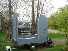 A variation on a covered wagon design. Compact and low profile for towing; tilt up the end walls and deploy the canvas on site.