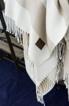 Striped white and beige throw from our Spring 2016 Collection.