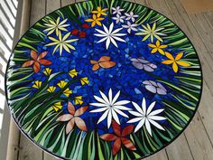"Resin covered Mosaic Table Stained Glass Custom made to order flowers garden spring patio ""In Bloom"". $899.00, via Etsy."