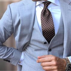 Gorgeous Blue suit accented with a dark brown tie.  These colors shouldn't work together but they do.