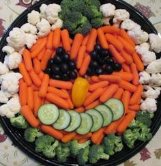 Halloween Veggie Tray Ideas | 12. Halloween Veggie Tray ~ Carrots are perfect for creating a pumpkin ...