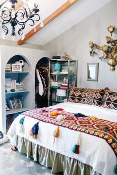 An eclectic bedroom filled with thrift-store finds