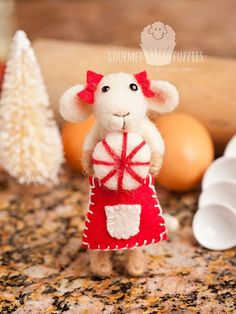 Camille the Candy Maker - Handcrafted, needle felted collectible. Camille comes with a needle felted peppermint candy, red wool felt bows and a matching red wool felt skirt apron! She's the perfect addition to your kitchen for the holiday season!