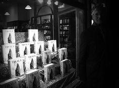 Richard Newton outside Daunt with the window display of his book, Tisala