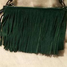 B Makowsky beautiful green suede bag This is a deep green suede crossbody bag with fringe detail on the front the handle is leather python print there are two zippered compartment and a small pocket on the back if you need more detail I will gladly send you some more pictures. Strap is adjustable B Makowsky  Bags Crossbody Bags
