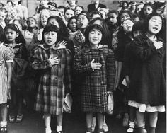 Japanese-American children saying the Pledge of Allegiance in an Internment Camp, 1942