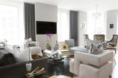 Open layout, Contemporary furnishings, soothing color palette.