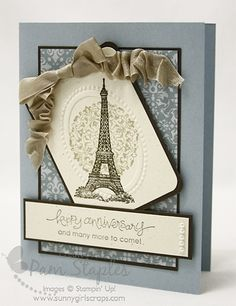 I love the lace-style circle behind the tower image, the colours of the card are lovely muted.