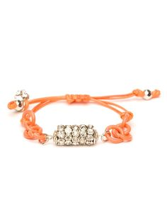 Bright, vibrant and beach-beautiful, this striking bracelet is a summertime essential. It features a playful set of orange links set against a glitzy cluster of crystals.