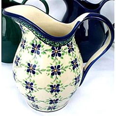Accent your meal service with this beautifully hand-painted Polish 2-quart pitcher. The pitcher is dishwasher safe for your convenience and it is virtually non-porous so it will not retain flavors.http://www.overstock.com/Worldstock-Fair-Trade/Handpainted-Two-quart-White-Blue-Floral-Stoneware-Pitcher-Poland/6535560/product.html?CID=214117 $64.99