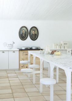 Some kitchen ideas - like the white with light marble tops; plus how clever is the seating that pops in and out?