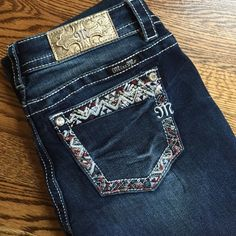 """NWT Miss Me Signature Bootcut Jeans NWT Miss Me signature bootcut jeans. Various sizes, all with 34"""" inseam.  Waist flat: size 25- 14""""; size 26-14 1/2""""; size 27-15""""; size 30-16""""; size 32-17""""; size 33-18"""".  Material 72% cotton, 27% polyester, 1% elastane. Mid rise, sits below natural waist. Slim fit through hip and thigh. Embellished back pockets. Miss Me Jeans Boot Cut"""