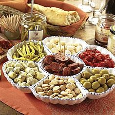 Easily serve a variety of the best Spanish tapas with this collection that includes a large ceramic serving tray, chorizo and much more. La Tienda offers the best of Spain delivered to your home - gourmet food, ceramics, wine and more.  Free catalog.