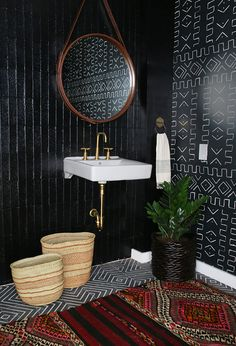 This bathroom by Interior Designer Amber Lewis of Amber Interiors is a perfect example of the signature style that her clients crave.