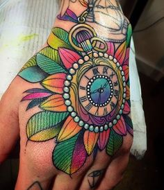 Colorful pocket watch hand tattoo