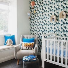 This geometric wallpaper accent wall makes SUCH an impact in this sweet nursery! So many details in this room make it a special space for baby. Link in profile to see every angle of this room. : @reid_loves
