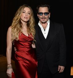 After nearly a year of marriage, Johnny Depp and his wife, Amber Heard, are still completely head over heels for each other. On Saturday night, Johnny hit the red carpet at the Art of Elysium Heaven Gala in LA with Amber by his side. The two nearly lit the red carpet on fire as they struck poses for photographers before heading inside and showing sweet PDA at their dinner table. Also in attendance was Johnny's ex-girlfriend and former What's Eating Gilbert Grape costar, Juliette Lewis, who…