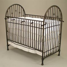 Vintage Iron Crib - would love one if I could find one!  Would probably paint it some fun color.