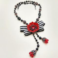 Bow poppy necklace beaded jewelry black white red pendant