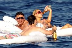 Paris Hilton drinking cristal champagne on an inflatable in  st. tropez!  july 2012 #celebs #frenchriviera