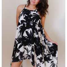 D R E S S Black floral with a cream colored background. It is a bit longer on the sides. ANGL Dresses