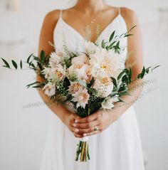 hand-tied bridal bouquet with pale peach flowers and greenery