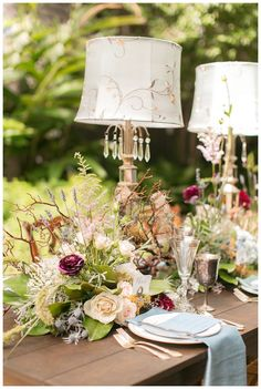 Outdoor wedding reception tabletop with lamps, vintage silver and autumn florals. Designed by Bee's Wedding & Event Designs and Blue Gardenia Events. Florals by Bee's Wedding & Event Designs. Image by Arte De Vie at Terrell House in New Orleans.