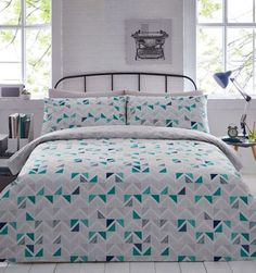 The  Stephen  bedding set from The Collection lends a modern feel to the bedroom with its multicoloured geometric print. Crafted from a super-soft cotton blend, this stylish set ensures a comfortable night s sleep.