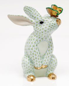 """Handcrafted bunny sculpture. Porcelain. Hand painted. 4.5""""W x 4.25""""D x 6.5""""T. Imported."""