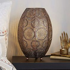Made with pressed metal with an intricate Moroccan inspired design this cylindrical table lamp features a beautiful brushed copper finish. Moroccan Table Lamp, Copper Table Lamp, Moroccan Lighting, Moroccan Decor Living Room, Eclectic Chandeliers, Copper Living Room, Retro Lighting, Lighting Ideas, Living Room Update