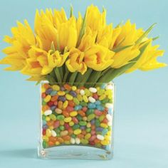 Easter Centerpiece.  I have done this many times with candy corn but this is a cute version for Easter.  Simply place a smaller vase inside the large one and fill the space inbetween with candy or marshmallow peeps and candy.