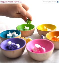 """Sorting bowls. These are 2.5"""" ring cups. Try 6"""" bowls and larger objects - spools, wood hearts, oversized buttons."""